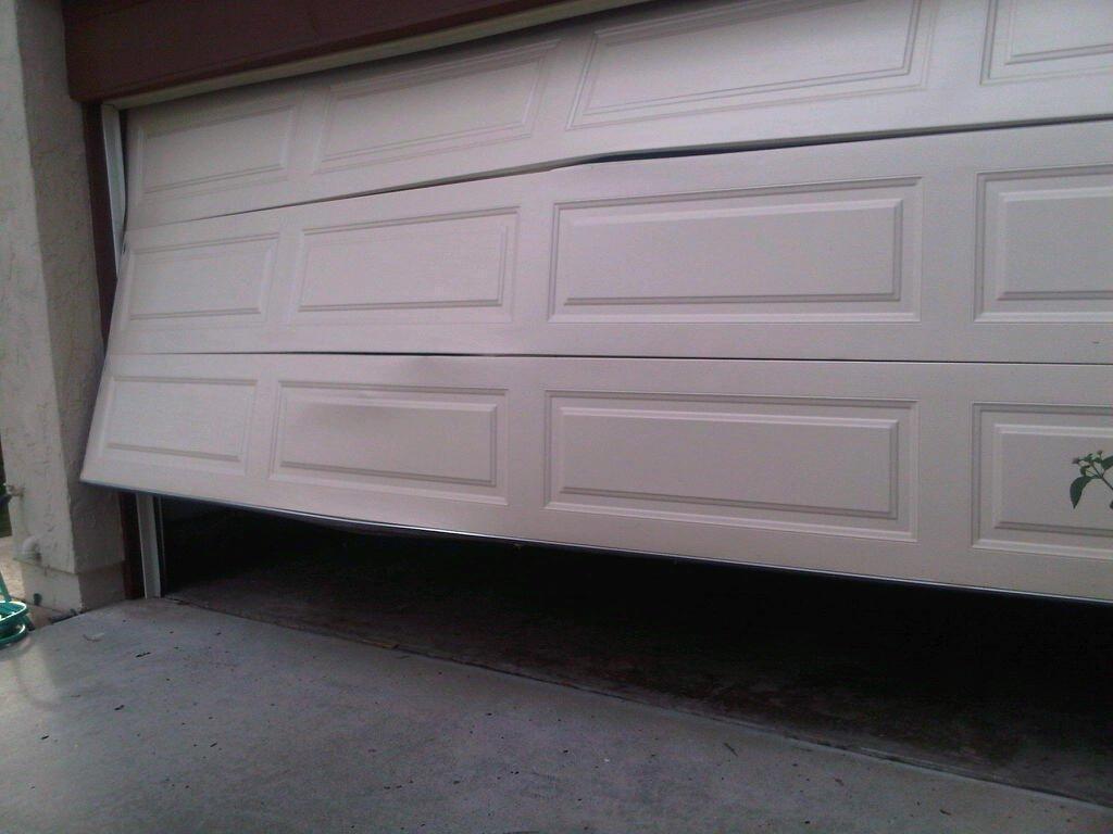 garage dent repair cost cable g door