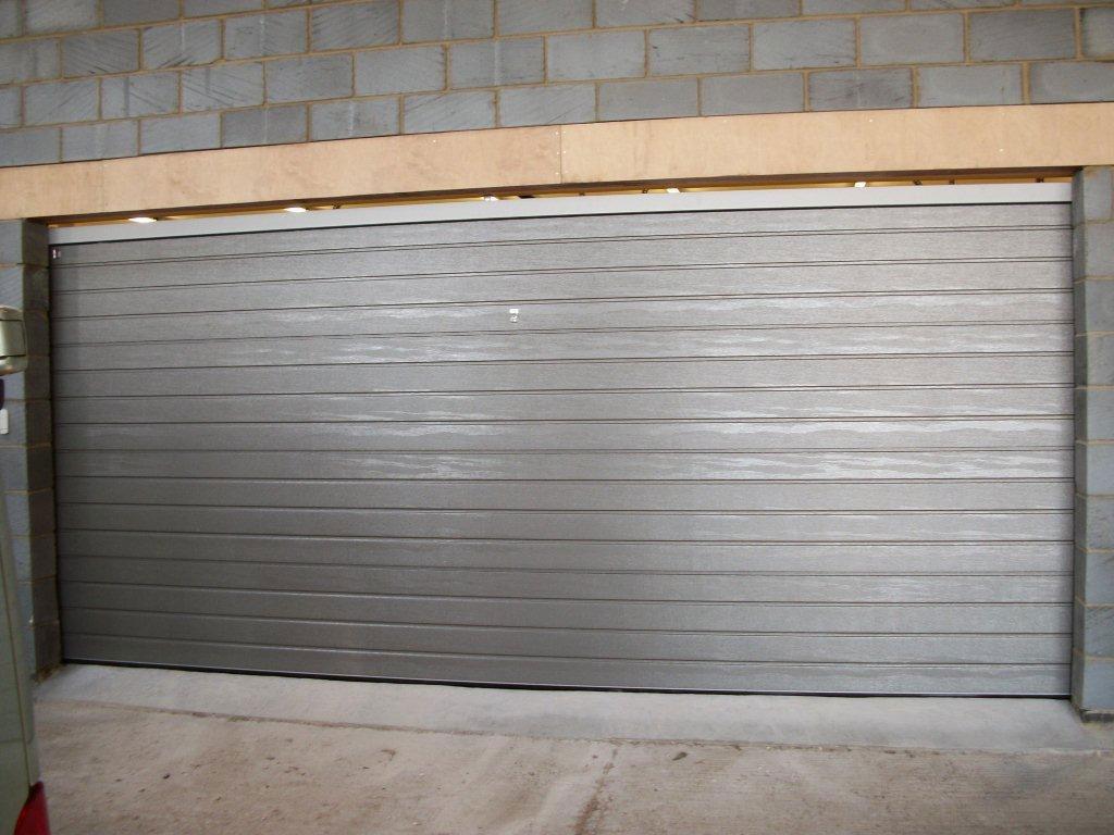 Sectional garage doors doormatic garage doors for 10 x 7 garage door prices
