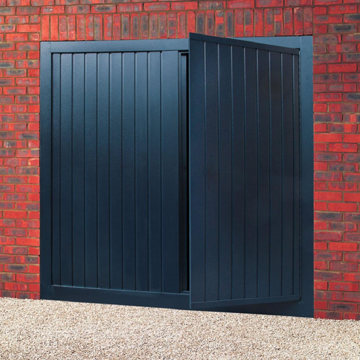 Steel Up Amp Over With Wicket Door Doormatic Garage Doors