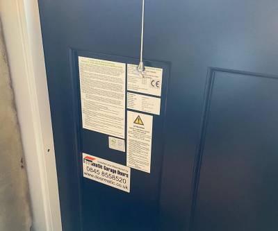 side-hinged garage door